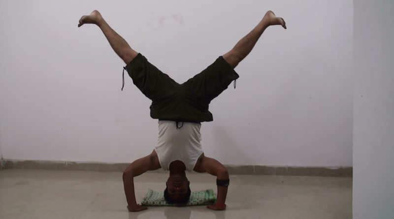 Bound Angle Pose in Head Stand